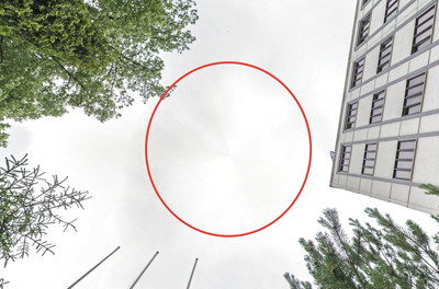 A conical spot on a spherical panorama of a street
